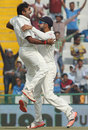 Amit Mishra and Virat Kohli are ecstatic after the wicket of AB de Villiers, India v South Africa, 1st Test, Mohali, 3rd day, November 7, 2015