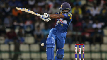 Kusal Perera attempts a pull shot during his fifty