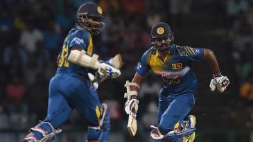 Lahiru Thirimanne and Kusal Perera complete a run during their 55-run partnership