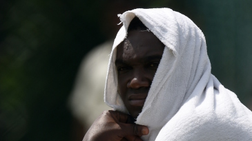 Jerome Taylor takes cools off during a practice session