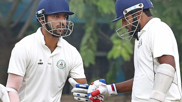 Wasim Jaffer taps his glove with Faiz Fazal after getting to 10,000 runs in Ranji Trophy