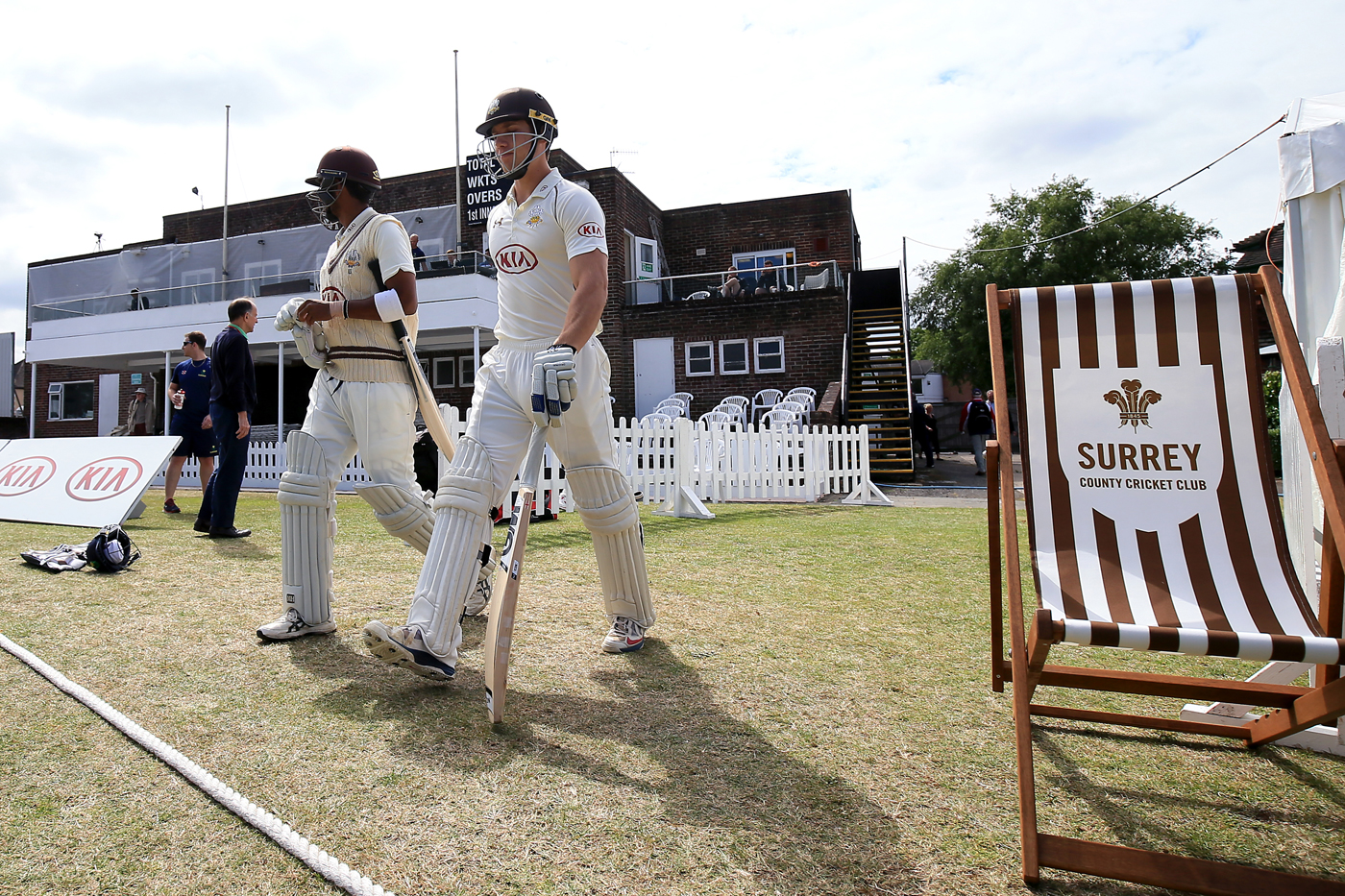 The young'uns: Arun Harinath (left) and Zafar Ansari walk out to bat against Glamorgan. Harinath made two hundreds in the game