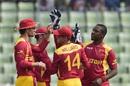 Tinashe Panyangara is mobbed by his team-mates, Bangladesh v Zimbabwe, 2nd ODI, Mirpur, November 9, 2015