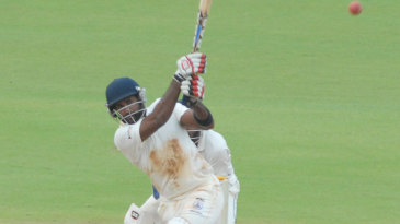 R Sathish launches one down the ground during his 33
