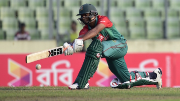 Mahmudullah plays a sweep shot during his fifty