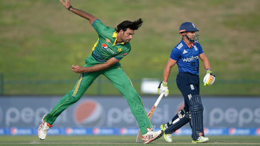 Even in his follow-through, Mohammad Irfan towers over the non-striker, James Taylor