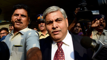 The BCCI  president Shashank Manohar is escorted out of the board's headquarters at the Wankhede stadium in Mumbai