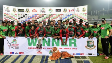 Bangladesh pose with the series trophy and a stuffed tiger