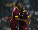 Kieron Pollard congratulates Dwayne Bravo after the latter took a wicket, Sri Lanka v West Indies, 2nd T20I, Colombo, November 11, 2015