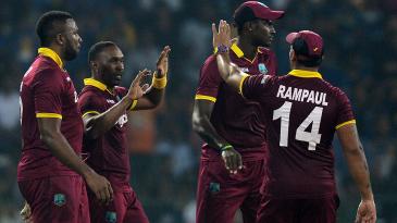 Dwayne Bravo celebrates a wicket with his team-mates