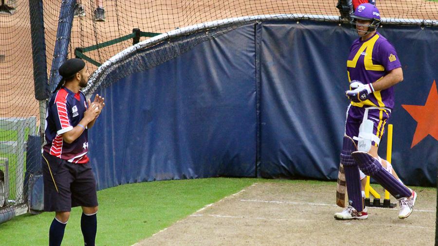 Jessy Singh talks to Matthew Hayden during a net session