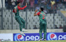 Mahmudullah and Mashrafe Mortaza celebrate a wicket, Bangladesh v Zimbabwe, 1st T20, Mirpur, November 13, 2015