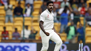 Varun Aaron exults after bowling Hashim Amla