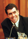 Sacked South African cricket captain Hansie Cronje smiles during his cross-examination at the King Commission of Inquiry into allegations of cricket match-fixing in Cape Town 23 June 2000. Hansie Cronje told the third day of cross-examination here that other players could be involved in match-fixing.