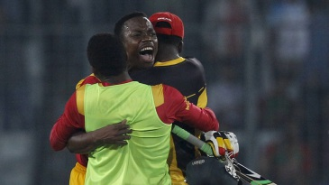 Neville Madziva is hugged by team-mates after he hit the winning runs