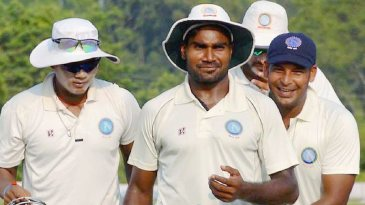 Rahul Shukla is congratulated by team-mates after finishing with a six-for