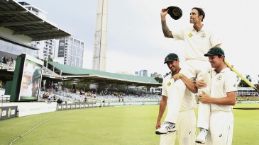 Mitchell Johnson is carried off on Mitchell Starc and Josh Hazlewood's shoulders