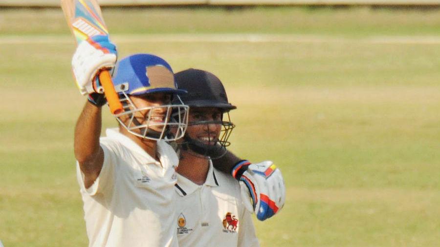 Captain Aditya Tare celebrates Mumbai's win with Siddhesh Lad