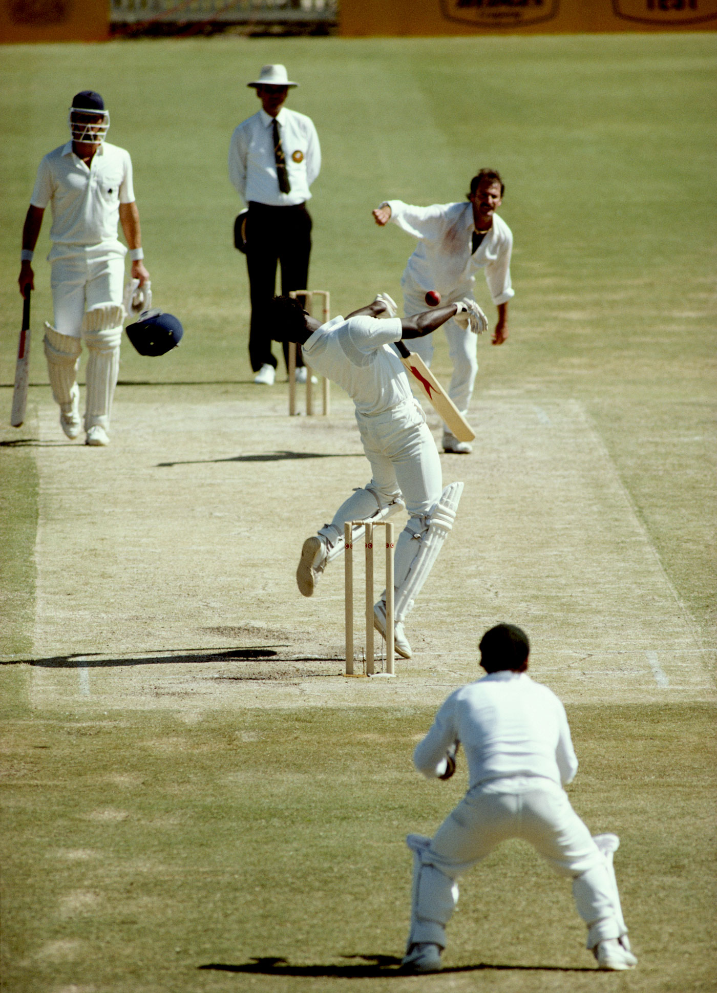 Do as Dennis: Norman Cowans loses his helmet while trying to avoid a bouncer in the 1982-83 Perth Ashes Test