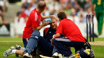 Andrew Flintoff receives an ice pack treatment after being hit on the helmet