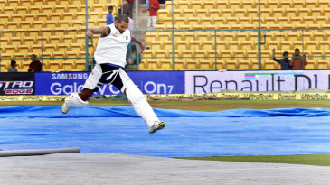 Shikhar Dhawan leaps over the covers
