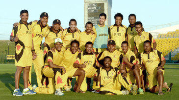 The Papua New Guinea players line up for a team photograph after beating Nepal