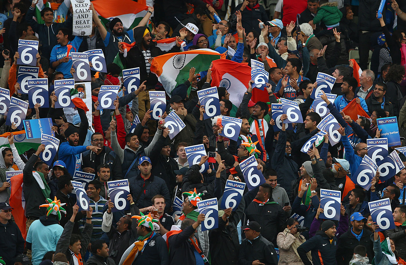 Indian fans celebrate holding