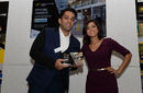Rehaan Rather collects the coach of the year award from Lucy Verasamy during the Chance to Shine Street awards at Kia Oval, November 19, 2015