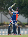 Ross Whiteley clubs one during a session in the middle, Dubai, November 22, 2015
