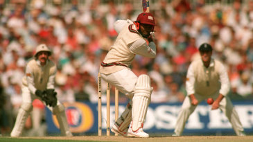 Brian Lara watches the ball