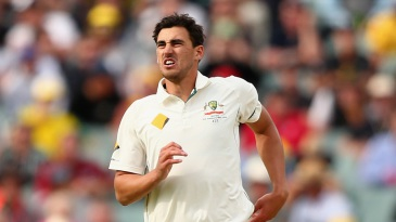 Mitchell Starc grimaces after hurting his ankle again