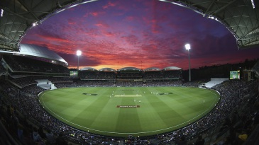 Play continues under lights and a blazing sunset