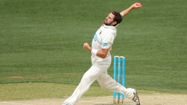 Chadd Sayers sends down a delivery