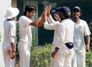Chaitanya Bishnoi is congratulated after a wicket, Vidarbha v Haryana, Ranji Trophy 2015-16, Group A, Nagpur, 1st day, December 1, 2015