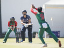 Fiona Urquhart strikes the ball back to Fahima Khatun, Bangladesh v Scotland, ICC Women's World Twenty20 Qualifier, Bangkok, November 29, 2015