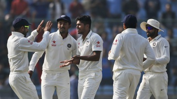 Umesh Yadav is mobbed by his team-mates