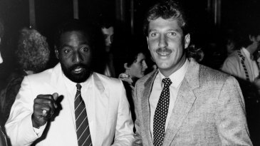 Viv Richards and Ian Botham attend a party