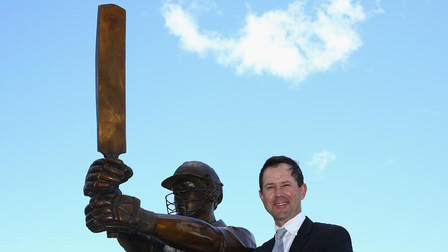 Ricky Ponting with a newly-unveiled statue of himself