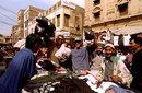Fanie de Villiers and Steve Palframan shop in a street in Pakistan, February, 1996