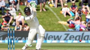 Martin Guptill drives off the front foot