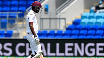 Kraigg Brathwaite walks back after being dismissed for 2