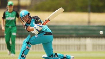 Ashleigh Barty sweeps during her first day of elite cricket