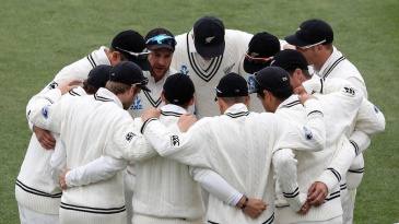 Brendon McCullum talks to his players in a huddle