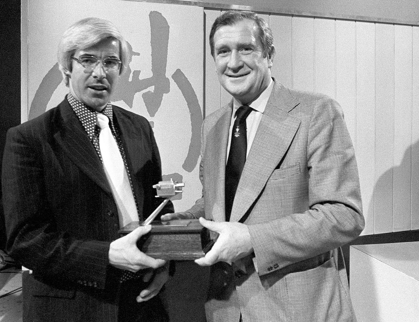 Receiving the BBC TV Grandstand Cricketer of the Year award from Jim Laker in 1975
