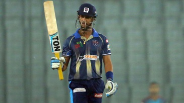 Lendl Simmons raises his bat after reaching his fifty