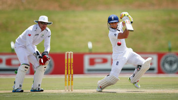 James Taylor drives through the off side during his half-century