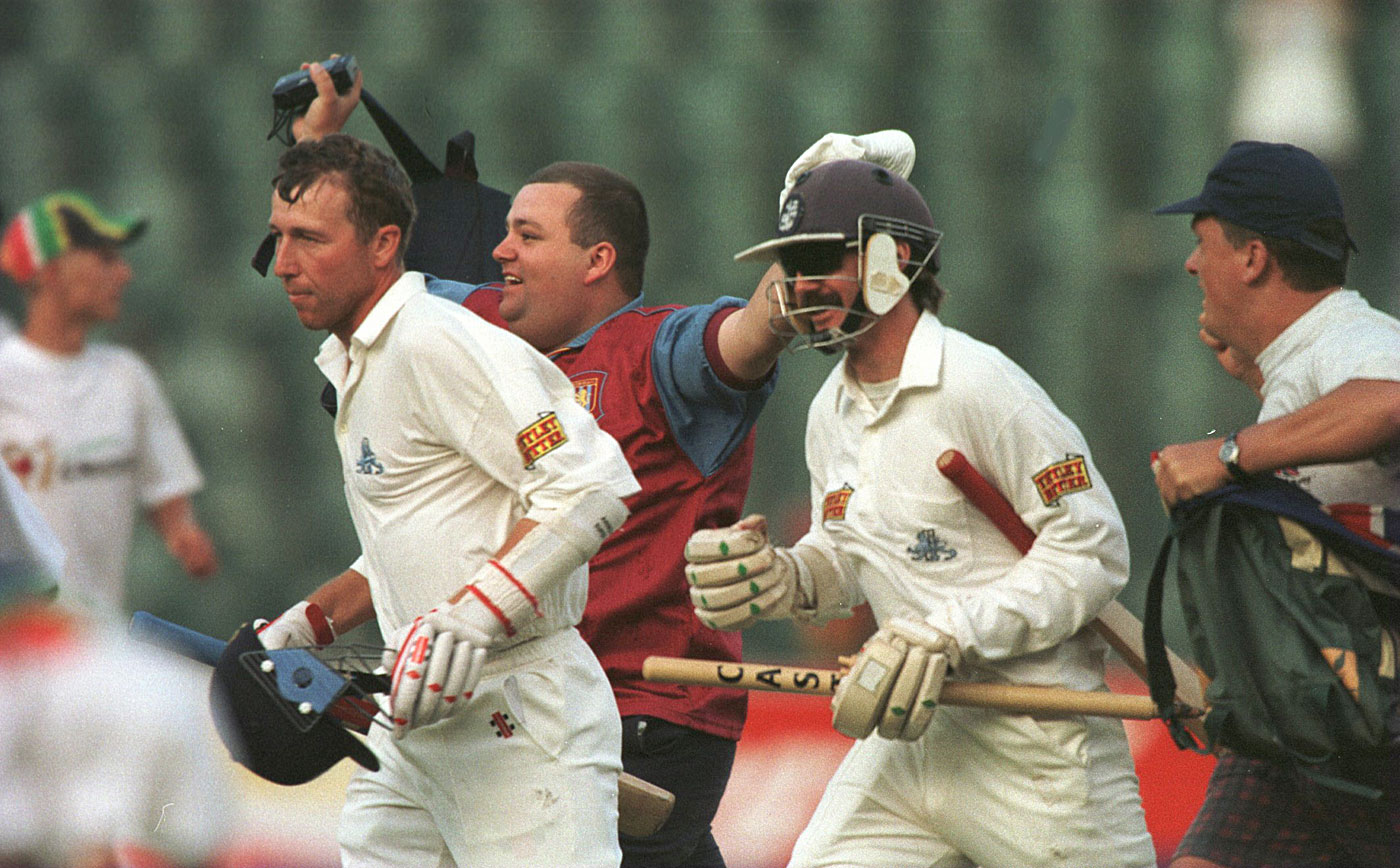 After the marathon, the sprint: batting gluttons Atherton and Russell run off the field after sealing the deal
