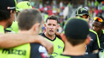 Michael Hussey talks to his players