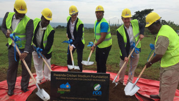 Makhaya Ntini lifts a spade at the ground-breaking ceremony that marked the start of construction on a new stadium in Rwanda