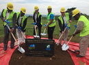 Makhaya Ntini lifts a spade at the ground-breaking ceremony that marked the start of construction on a new stadium in Rwanda, Gahanga, Rwanda, December 16, 2015